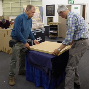 Two volunteers packing the Tapestry