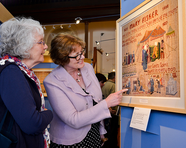 visitors enjoying the Quaker Tapestry